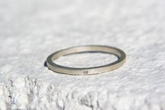 Thin delicate sterling silver square stacking band set. Flush 1mm eco-friendly diamonds. Wedding or engagement ring, anniversary, or holiday. $115.00, via Etsy.