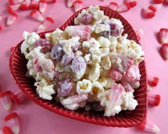 Cupid Crunch  1 (24 oz) package vanilla Almond Bark  2 bags of lightly salted microwave popcorn, popped (approximately 16-20 cups popped popcorn)  1 1/2 cups Valentine candy corn  1 cup dry roasted, salted peanuts  1 1/2 cups M (Valentine colors)