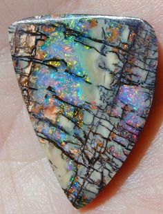Boulder Opal. So beautiful! I'm trying to figure out how to make milky, translucent glass like this to fuse with.