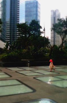little red hat girl skipping in hong kong.  total joy of life :)