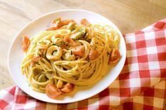 Pasta con calamari pomodorini e olive tenere ascolane