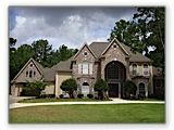 Kingwood home roofed with Driftwood Owens Corning® Duration® Shingles