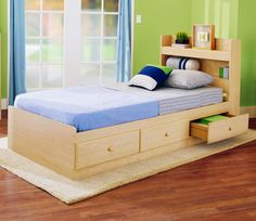 14 Lovable and Cute Kids Bed Designs You Must Have : Amusing Kids Single Bed Drawers with Wooden Bookcase Headboard and Blue Curtain also Wooden Laminate Floor