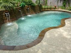 Viking Pools.  Love the retaining wall with the small water falls.  And I like the border around the pool.