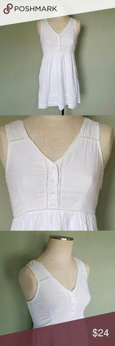 Urban Outfitters Pins and Needles White Dress Pins and Needles brand. From Urban Outfitters. Size Medium. Fit and flare style babydoll sundress. Solid white with subtle white pinstripes. Button up bust. Side zipper. Exposed stitching details. Excellent condition! Urban Outfitters Dresses Mini
