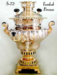 """Rare Tombak Bronze Hand Made Samovar. Elaborately fluted Turnip shape with Pearled upper rim, decorated S-scroll handlepieces, and a double pierced waist. Set atop a square, footed base with marker's marks: """"Steam Factory of Heirs to Vasily Stepanovich Batashev - City of Tula."""" Dated 1898. Award Stamps, matching Tombak finials and fittings. An outstanding Samovar of the red-gold color that is only Tombak."""