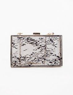 Drop your day bag apres-5pm and reach for this lacy lucite clutch instead, $51 at PixieMarket.