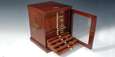 An eample of early coin collection storage: mini coin cabinet