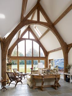 vaulted ceiling wooden beams floor to ceiling windows More