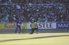 Action photo with Mark Boucher poised for a catch at Newlands in 2011. Photo taken by Tim Dale Lace