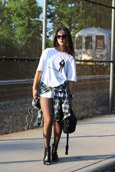 Vera wearing Versace t-shirt, Chanel booties, Alexander Wang bag, Chanel glasses and Abercrombie & Fitch flannel.