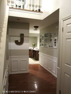The blog's main  focus is the striped walls. My main focus is the bottom portion of the walls - crown molding in middle of walls in the color paint of your choice and add picture frames spaced apart. Instant wainscoating! Your welcome! ;)