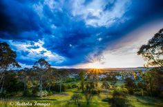 Amazing photo of sunset and approaching storm taken at Martin's Lookout. Photo by Buttola Images.   Forecast temperature: 8 - 21 degrees Daily forecast: Cloudy. Very high (90%) chance of showers. Thunderstorms likely in the afternoon and evening. Light winds becoming northwest to northeasterly 15 to 20 km/h in the morning then tending east to northeasterly in the early afternoon. Overnight temperatures falling to between 8 and 15 with daytime temperatures reaching between 18 and 25.