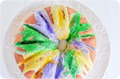 Traditional Mardi Gras King Cake, filled one of two ways: with cinnamon pecan praline or a cherry bourbon cream cheese, quick and easy, great beginner recipe!