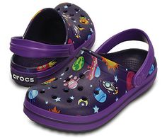Get ready for a far-out adventure in our bold Crocband™ Galactic Clogs. They feature colorful space-themed graphics including stars, planets and rocket ships. All of the Crocs comfort kids love is here, thanks to Croslite™ foam construction and a pivoting heel strap. Free shipping on qualifying orders.
