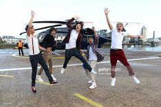 FOR EDITORIAL USE ONLY) L-R Liam Payne, Louis Tomlinson, Harry Styles, Zain Malik and Niall Horan of One Direction travel in a luxury helicopter to Glasgow, Manchester and London on September 11, 2011. The tour was taken in a luxury helicopter to launch their first single 'What Makes You Beautiful' released on the 12th September.