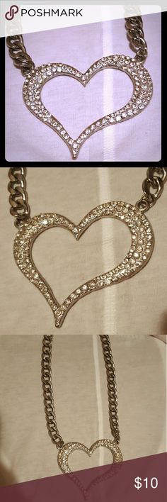 Beautiful Silver Rhinestone Heart Necklace Large Rhinestone Heart Necklace. This necklace is beautiful with so many different outfit styles! It has been gently used, but has no missing rhinestones and is in great condition. Jewelry Necklaces