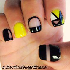 Yellow black gel nail art