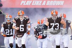 Quarterback Brian Hoyer of the Cleveland Browns and tackle Joe Thomas run  onto the field during c20ac7c19