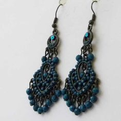 Modern turquoise dangling Eastern Dreams earrings Chandelier and hippy style that has both unusual turquoise cabochon and beads
