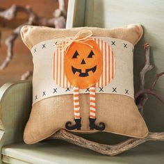 Featuring a cross-stitched fabric band and a smiling Jack O& Lantern applique wearing a witches hat, this Halloween wrapped pillow would look cute in your living room family room, or bedroom. Pillow with Pumpkin Dangle Leg Pillow Wrap. Halloween Quilts, Halloween Sewing, Fall Sewing, Halloween Pillows, Halloween Home Decor, Fall Halloween, Halloween Crafts, Halloween Decorations, Fall Decorations