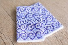 Hand-knitted purple color wrist warmers decorated with blue/purple/white beads
