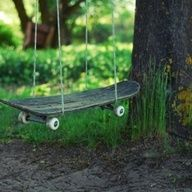 Old skateboard giving a second life as a beautiful garden swing set.