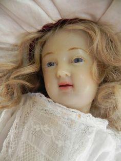 Wax religious doll