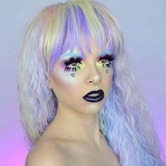 Serving up some REAL #PastelGoth vibes in the @rockstarwigs.cosplay #RhapsodyCollection - #PastelRainbow it's @kimberleymargarita_! Be sure to check out her YouTube channel for other mystical looks!  www.ROCKSTARWIGS.com  Contact us at 585-482-8780 for more information or check out select costumes and accessories on our Amazon page or website www.arlenescostumes.com