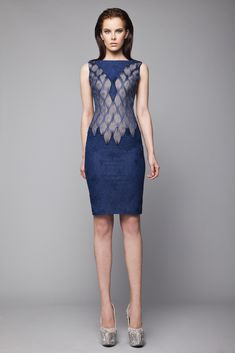 Short fitted Navy knee length dress in Lace, with honeycomb Crinoline pattern over a Skin corset.