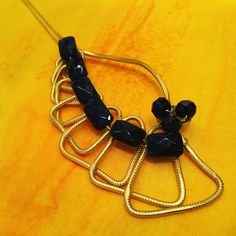 This hand crafted wire & cut glass pendant by #pictordesign is such an interesting piece!  Find more unique designs like this one at our online shop: link in bio.  #handmade #jewelry #handcrafted #pendant #necklace #pendantdesign #gold #black #glass #wiredesign #jewelrydesign #uniquependany #handmadejewelry #unique #handpainted #silk #handcrafted #art #craft #fashion #style #design #ljubljana #madeinslovenia #pictorshop