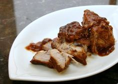 Slow cooked pork ribs in the crock pot with apple juice, barbecue sauce, garlic, and brown sugar. Pork rib barbecue using boneless country-style ribs