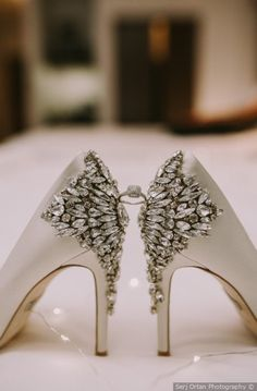Glam wedding shoe inspo - jeweled heel white heels displaying wedding ring {Serj Ortan Photography}