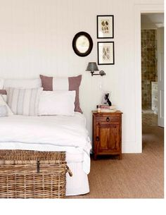 Classic white bedroom with a touch of brown.  #cosybedroom #canebasket #whitebedroom