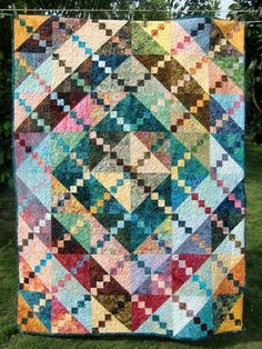 """Bali Sunrise"" Quilt – This nicely sized quilt measures 51 ½ by 68 1/2 inches, and is the perfect size for a throw or couch quilt. So bright"