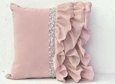 This latte beige ruffled sequin pillow with swaths of georgette undulate across the distinctive whispy ruffle pillow, adding elegant depth and interest to your room decor. The sequin and crystal detai