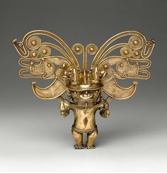 Figure Pendant, Date: 10th–16th century, Geography: Colombia, Culture: Tairona, Medium: Gold.-'There are two types of cacique: one is fully human (shown here); the other is similar but has the head of a bat or crocodile. Such a powerful image could only have been worn by individuals who were themselves powerful in Tairona society.'