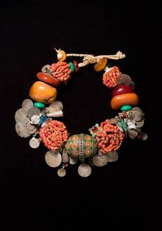 Berber enameled bead with coral, old coins. Draa Valley, Morocco.National Museum of African Art | Desert Jewels: North African Jewelry and Photography from the Xavier Guerrand-Hermès Collection