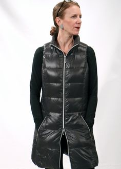 Coatology Long Vest.   Edgy interpretation of the down vest, Coatology outerwear piece is warm and cool. Grey metallic color is fashion, double zipper is function. https://www.forecaststore.com/online-store/what-s-new/fall-collection/coatology-long-vest-detail