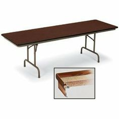 "KI Solid Core Standard Folding Tables - Walnut top/black edge/black frame by KI. $226.00. KI Solid Core Standard Folding Tables have an 3/4"" Novoply core that resists warping. 18-gauge one-piece welded channel steel apron and understructure are fastened to the top every 2"". .022"" burn- and mar-resistant high-pressure laminate surface. Rounded corners and bull-nose vinyl edging all around. Side brace channel folds legs flush within apron bottom. Non-chipping enamel steel tube legs."