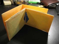 How to make an easy origami wallet. ( billetera de papel ) This video explains how to make an easy paper wallet. For more videos How to make a Paper Claw htt. Origami Wallet, Diy Wallet, Purse Wallet, Tyvek Wallet, Fabric Wallet, Paper Purse, Paper Crafts, Diy Crafts, Adult Crafts