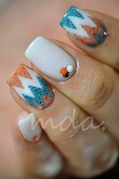 white with blue and orange chevron root and jewels nail art design