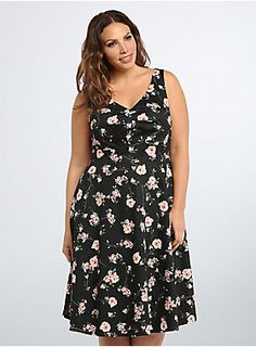 """<p>Ka-bloom! This swing dress is just what your spring wardrobe needs. Black cotton lends stretchy-swing you'll love, while the pink floral print brightens up the style. A pleated bodice plays up your bust, only to extend into a tummy-concealing flared skirt.</p>  <p></p>  <p><b>Model is 5'9.5"""", size 1</b></p>  <ul> <li>Size 14 measures 44 1/2"""" from shoulder</li> <li>Cotton/spandex; lining: polyester</li> <li>Wash cold, dry flat</li> <li>Imported plus size dr..."""