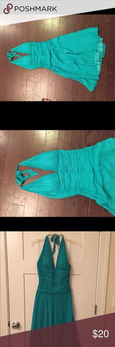 Cache Dress Size 4 Cache halter style dress. Knee length. Turquoise/Teal. Women's Size 4. Bunched around stomach. Zips on the side.  100% acetate with silk lining Cache Dresses