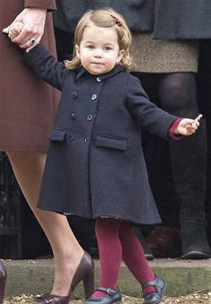 Princess Charlotte holding a candy cane as she attends church in the village of Buckleberry, the Middleton family's West Berkshire home, on Christmas Day in December 2016