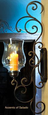 Tuscan Wall Decor . The wrought iron fixed on the wall can hold anything a lamp , vase or even  a bell