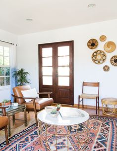 Handwoven baskets make for a unique wall accent in this modern bohemian space.