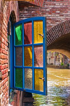 Colorfu glass in this window overlooking a river