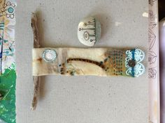 Beach Day stitching - eucalyptus dyed wool, embroidery, lace bits, and hand painted Rock Being