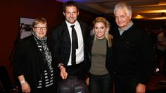 Richie McCaw poses with his parents Don and Margaret and girlfriend Gemma Flynn with a cake celebrating his world record 142 test caps.